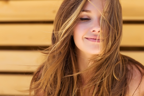 beautiful woman smiling with her eyes closed