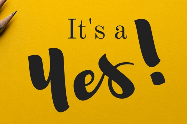 """It's a Yes!"" text in yellow backdrop"