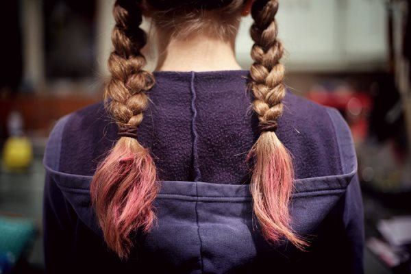 Color-treated hair with split ends.