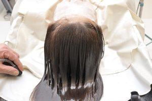 Washing silky straight hair.