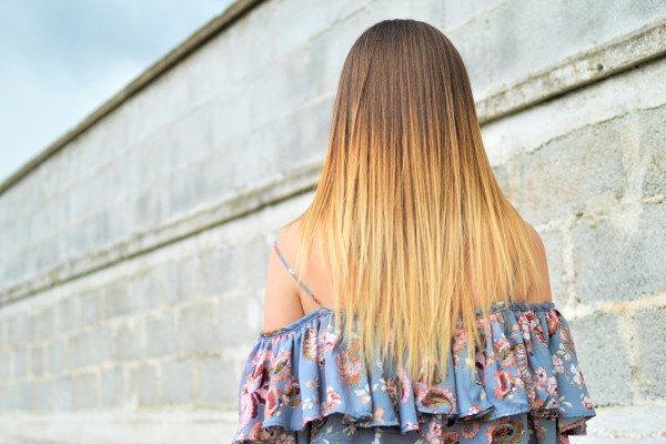 back view of a girl with blonde hair