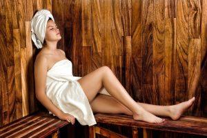 Woman relaxing while using argan oil hair treatment