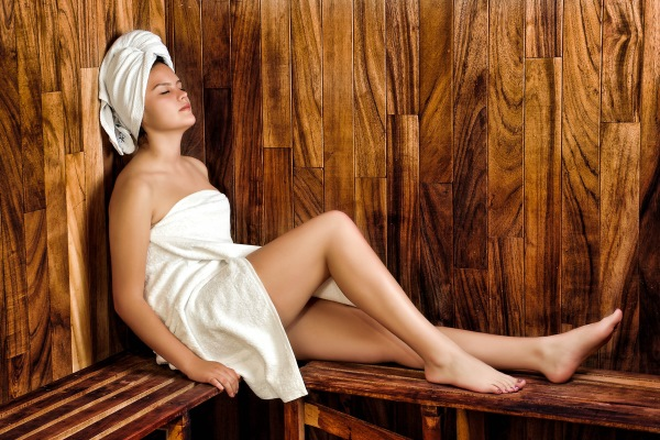 Woman relaxing while using argan oil hair treatment