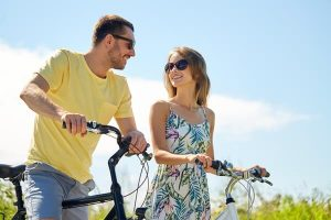 A happy couple on a bicycle ride