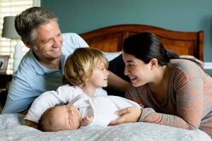 Happy family in the bedroom