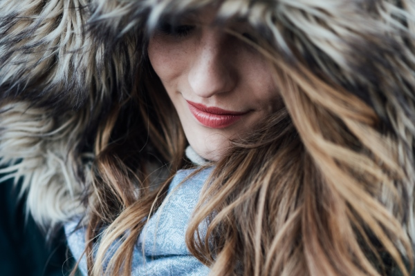 Young woman with fur hood