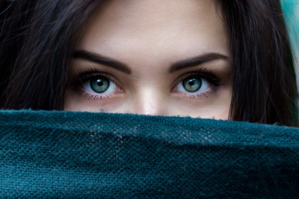 Close-up of a woman's green eyes