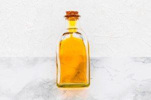 Argan oil in clear glass bottle